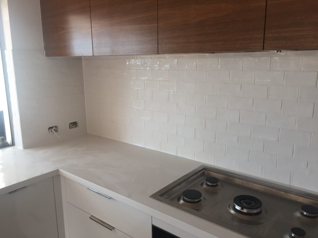 Kitchen tilers gold coast kitchen tilers tweed heads kitchen new kitchen tiles are also a great way to give your existing kitchen a fresh modern look below are some examples of kitchen laundry tiling by our gold dailygadgetfo Image collections